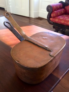 Adelaide Nelson's saucepan. The Marquis de Lafayette's initials are seen on the lid, which was not recovered until 20 years after it had been buried.